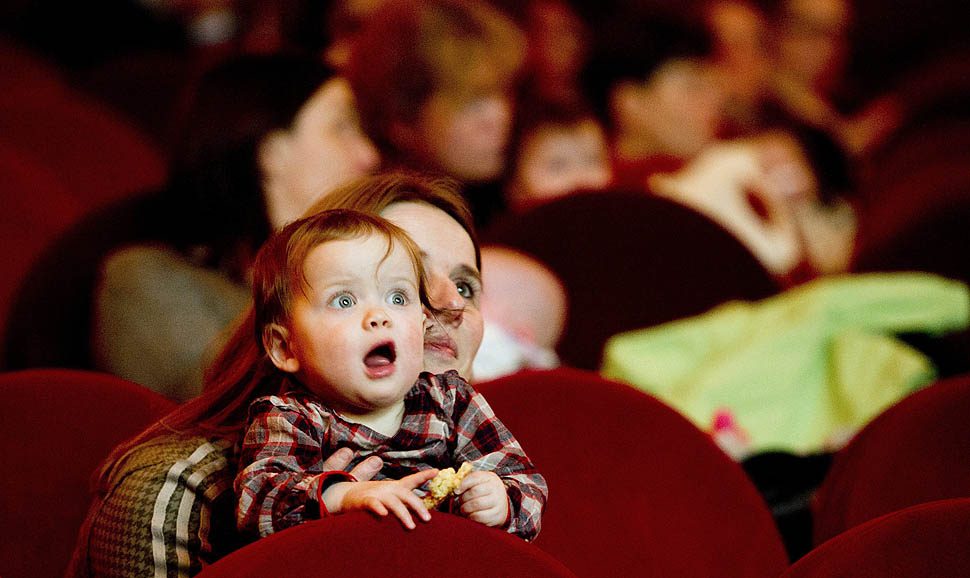 A mother accompanied with her baby attends a movie at the cinema 'The Movies' in Amsterdam. From now on, the cinema offers an special program for parents who want to watch the movies with their babies. =